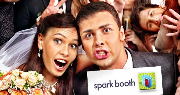 Bride and groom having fun with Sparkbooth